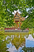 Thai Sala with Buddha statue on a platform in water, Westpark, Munich, Upper Bavaria, Bavaria, Germany