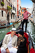 Couple in a gondola, Gondola in the canals of Venice, Venetia, Italy, Europe