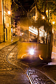 Electrico 28 tram in the Alfama district at night, Lisbon, Lisboa, Portugal