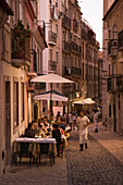 People sitting outdoors and enjoying dinner at Alfaia restaurant in Bairro Alto district, Lisbon, Lisboa, Portugal