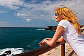 Young woman looking out to sea, Los Molinos, Fuerteventura, Canary Islands, Spain, Europe