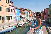 Young woman on a bridge, Burano, Venice, Venezia, Italy, Europe