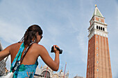 Young woman taking a photo of the tower, San marco, Piazza San Marco, Marcus Place, Venice, Venezia, Italy, Europe