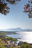 Coastal road leading to S'Illot chapel, view over Playa S'Illot beach, Alcudia peninsula, bay of Pollenca, Mallorca, Balearic Islands, Spain