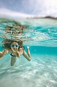 Girl diving in bay Cala S Amonia, Mallorca, Balearic Islands, Spain