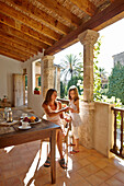 Mother and daughter at loggia, Algaida, Mallorca, Balearic Islands, Spain
