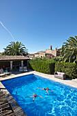 Two girls swimming in a pool, Finca, Algaida, Mallorca, Balearic Islands, Spain