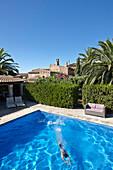 Girl swimming in a pool, Finca Raims, Algaida, Mallorca, Balearic Islands, Spain
