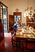 Woman in the dinner and breakfast room, Finca Raims, rebuilt vineyard and country hotel, Algaida, Mallorca, Balearic Islands, Spain