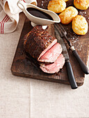 Sliced beef gravy and roast potatoes. Roast Beef Prot Jus _ Crispy Baked Potatoes, Salt, Jus