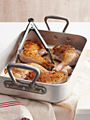 Roast chicken in pan. Roast Chicken Step _ Browning in roasting pan