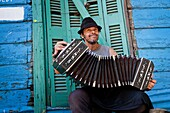Musician playing the bandeon at Caminito area in La boca  Buenos Aires, Argentina