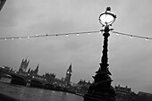 England Lamposts Over River Thames At Night with Big Ben and Houses Of Parliament in Background, London, United Kingdom. England Lamposts Over River Thames At Night with Big Ben and Houses Of Parliament in Background, London, United Kingdom