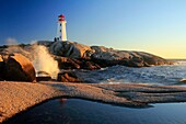 waves crashing on rocks at Peggy´s Cove Lighthouse, Nova Scotia, Canada