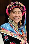 China, Sichuan, Kham, Danba, Young tibetan woman wearing the local traditional dress