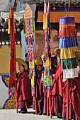 China, Qinghai, Amdo, Tongren Rebkong, Monastery of Gomar Guomari Si, Losar New Year festival, Opening ceremony, Banners bearers
