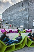 People at the Museumsquartier, in background the Mumok,Vienna, Austria, Europe