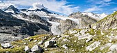 Valley head of valley Obersulzbachtal in the NP Hohe Tauern  The peaks of Mt  Grosser Geiger, Mt  Maurerkeeskopf and Mt  Schlieferspitz  The National Park Hohe Tauern is protecting a high mountain environment with its characteristic landforms, wildlife an