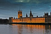 Houses of Parliament, Thames river at evening cloudy , London, England  UK