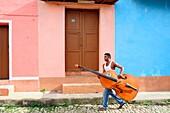 A Cuban musician off to work in Trinidad,Sancti Spiritus Province,Cuba