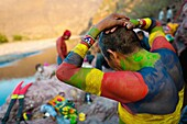 "A Cora Indian man, painting his body in colors, prepares himself for the religious ritual ceremony of Semana Santa Holy Week in Jesús María, Nayarit, Mexico, 22 April 2011  The annual week-long Easter festivity called ""La Judea"", performed in the rugged m"
