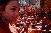 People throw and splash tomato pulp during La Tomatina festival in Bunol, Spain, 31 August 2006  La Tomatina is a tomato fight held annually in the town of Bunol, close to Valencia  Approximately 40,000 people from all over the world arrive to fight in th