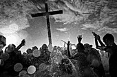 Catholic followers bath the wooden cross in the sea during the annual Holy Week ritual Lavado de la cruz in Santa Elena, Ecuador, 3 April 2012