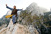 Shaolin Monk Shi De Jian of the San Huang Zhai Monastery demonstates traditional martial arts on the mountainside of Song Mountain