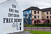 Free Derry sign and Mural on the wall of house in Bogside, Londonderry, Northern Ireland