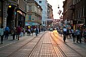 Tramlines and cobbled pavement on Ilica street reflecting late sunshine, Zagreb, Croatia