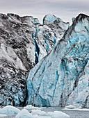 Ice walls- Jokulsarlon Glacial Lagoon, Breidarmerkurjokull Glacier, Vatnajokull Ice Cap, Iceland Ash seen in the ice due to volcanic eruptions from Grimsvotn