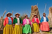 Lake Titicaca Peru with local traditional women of Uros Tribe history in colorful clothes near Puno