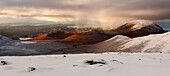 Vast panorama of the snow-covered North West Highlands with the view to the summit of Sail Mhor in the An Teallach mountains, Scotland, United Kingdom