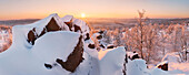 Low evening sun illuminating the snow-covered Lugstein Mountain and the forests of the Eastern Ore Mountains, Zinnwald, Saxony, Germany