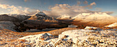 Vast panorama of the snow-covered North West Highlands overlooking the summits of Sgurr Dubh, Liathach and Beinn Eighe (from left) over the Loch Clair in winter, Scotland, United Kingdom