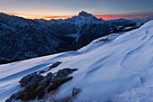 Sunset with snow structures on the plateau of Monte Piano, looking west to the Dolomiti di Braies, Sexten Dolomites, South Tyrol, Italy