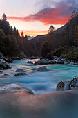 Sunset above the turquoise white water river Soca in the Triglav national park in the Julian Alps, Gorenjska, Slovenia