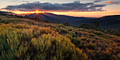 Sunset above the Sierra de Guadarrama in central Spain in autumn, Castile and Leen, Spain