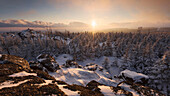 Cold Sunset with a wide view from Medvedi skala above the heavily snow covered Ore Mountains, Ustecky kraj, Czech Republic