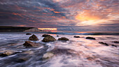 Spectacular sunrise above the bay of Cuckmere in the southern English county Sussex with the impressive chalk cliffs of the Seven Sisters in the background, England, Great Britain