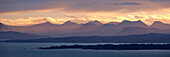 View from the Isle of Skye to the Highlands of Wester Ross in the early morning light with the island of Raasay in the foreground, Scotland, United Kingdom