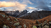 An impressive panorama of the Ortler Alps from a mountain meadow above the Stelvio Pass on an autumn evening, South Tyrol, Italy