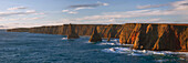Impressive panorama from Duncansby Head on the northeast coast of Scotland to the wild cliffs and the Duncansby Stacks, United Kingdom
