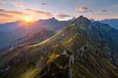 Sunrise above the Alps with view towards the Grat Mountain between Diepen and Rophaien, Lake Lucerne, Canton of Uri, Switzerland