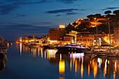 Illuminated marina at the Bruna river mouth, Castiglione della Pescaia, seaside town, Mediterranean Sea, province of Grosseto, Tuscany, Italy, Europe