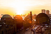 Sunset over the old Elbtunnel and the Landungsbruecken at the habour, Hamburg, Germany