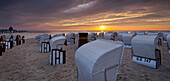 Hooded beach chairs near Sellin pier in the morning light, Ruegen, Mecklenburg-Western Pomerania, Germany