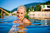 Young woman in a swimming pool of a hotel, Fladnitz an der Teichalm, Styria, Austria