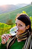 Young woman holding a glass of white wine, Spielfeld, Styria, Austria
