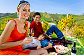 Three young people having a picnic, Styria, Austria